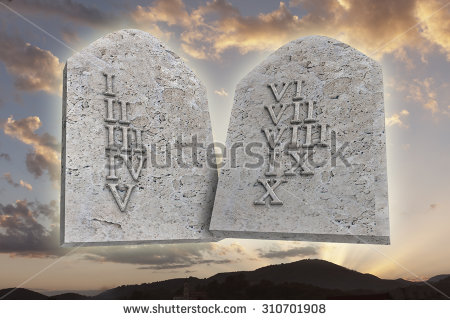 stock-photo-the-ten-commandments-on-a-sunset-background-310701908